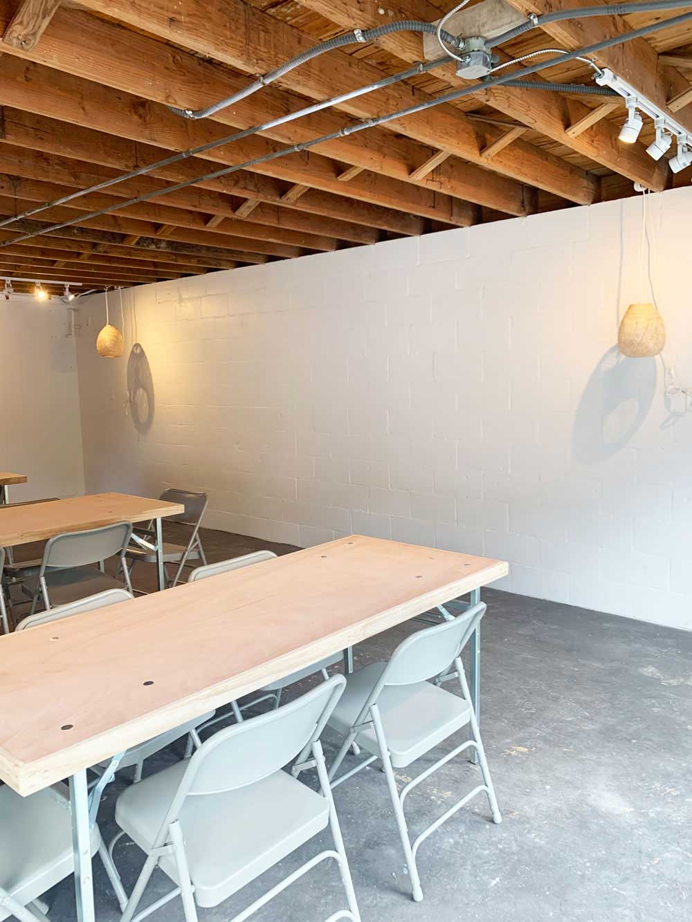 small industrial space with wood tables and chairs